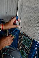NEPAL Kathmandu, Lalitpur, tibetan refugee camp Jawalakhel, carpet factory JHC Jawalakhel Handicraft Center, tibetan women knot carpets for income generation / tibetische Fluechtlinge, tibetisches Fluechtlingslager Jawalakhel, Teppichfabrik JHC Jawalakhel Handicraft Center, tibetische Frauen knuepfen Teppiche
