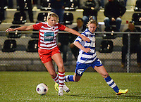 20140221 - OOSTAKKER , BELGIUM : Antwerp Sophie Mannaert (l) pictured with Gent Margaux Van Ackere (r) during the soccer match between the women teams of AA Gent Ladies  and RAFC Antwerp Ladies , on the 19th matchday of the BeNeleague competition Friday 21 February 2014 in Oostakker. PHOTO DAVID CATRY