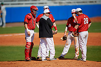 Bradley Braves manager Elvis Dominguez makes a pitching change as catcher Keaton Rice (15), third baseman Brendan Dougherty (26) (behind Dominguez), shortstop Luke Shadid (10), and first baseman Connor Manthey (28) look on during a game against the Dartmouth Big Green on March 21, 2019 at Chain of Lakes Stadium in Winter Haven, Florida.  Bradley defeated Dartmouth 6-3.  (Mike Janes/Four Seam Images)