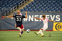 FOXBOROUGH, MA - SEPTEMBER 04: Michael Vang #8 Forward Madison FC takes a shot at goal with Tiago Mendonca #33 of New England Revolution II trying to intercept during a game between Forward Madison FC and New England Revolution II at Gillette Stadium on September 04, 2020 in Foxborough, Massachusetts.