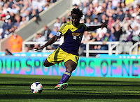 Pictured: Wilfried Bony of Swansea takes a shot at goal. Saturday 19 April 2014<br />