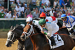 June 12,  2010:  Battle Plan and General Quarters lead the field past the wire the first time around in the 29th running of the G1 Stephen Foster Stakes at Churchill Downs in Louisville, Kentucky.