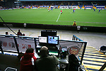 FC United of Manchester 8, Glossop North End 0, 28/10/2006. Gigg Lane, Bury, North West Counties League division one. Two editors watching live video feeds of the action as FC United of Manchester take on Glossop North End (blue shirts) in a North West Counties division one match at United's home stadium, Gigg Lane, home to Bury FC. The match was staged on People United Day, an event started in 1999 which brought together fans from across Europe to campaign against racism. FC United were formed in the summer of 2005 by supporters of Manchester United in response to the take over of their club by American millionaire Malcolm Glazer and his family. The club entered the football pyramid at the lowest level with the intention to climbing through the leagues. FCUM won the match 8-0, watched by 3257 spectators. Photo by Colin McPherson.