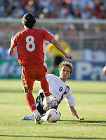 USA's Michael Bradley (r) tackles the ball away from China's Li Tie. The USA defeated China, 4-1, in an international friendly at Spartan Stadium, San Jose, CA on June 2, 2007.