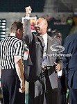 North Texas Mean Green head coach Johnny Jones talks to the referee during the NCAA  basketball game between the South Alabama Jaguars and the University of North Texas Mean Green at the North Texas Coliseum,the Super Pit, in Denton, Texas. UNT defeated South Alabama 82 to 79...
