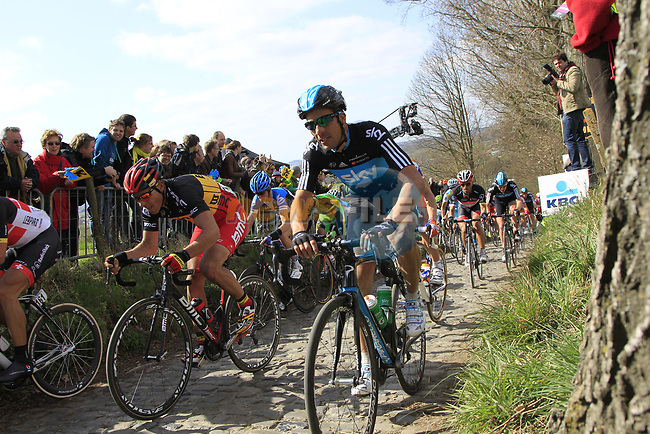 The peloton including Philippe Gilbert (BEL) BMC Racing Team and Juan Antonio Flecha (ESP) Sky Procycling climb Koppenberg during the 96th edition of The Tour of Flanders 2012, running 256.9km from Bruges to Oudenaarde, Belgium. 1st April 2012. <br /> (Photo by Eoin Clarke/NEWSFILE).