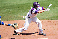 Eric Stamets (8) of the Evansville Purple Aces follows through hiss swing during a game against the Indiana State Sycamores in the 2012 Missouri Valley Conference Championship Tournament at Hammons Field on May 23, 2012 in Springfield, Missouri. (David Welker/Four Seam Images)
