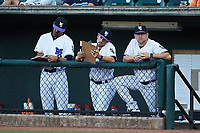 (L-R) Winston-Salem Dash coaches Mike Daniel (8), Danny Farquhar (3) and Ryan Newman (5) watch from the dugout during the game against the Greensboro Grasshoppers at Truist Stadium on June 17, 2021 in Winston-Salem, North Carolina. (Brian Westerholt/Four Seam Images)