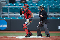 San Diego State Aztecs catcher Deron Johnson (41) and home plate umpire Mac Smith track a pop fly during the game against the UNCG Spartans at Springs Brooks Stadium on February 16, 2020 in Conway, South Carolina. The Spartans defeated the Aztecs 11-4.  (Brian Westerholt/Four Seam Images)