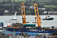Pictured: 200 ton column being loaded onto giant heavy lift ship at Pembroke Dock, Wales, UK<br />