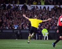 Footballer turns asn celebrates as he scores a goal