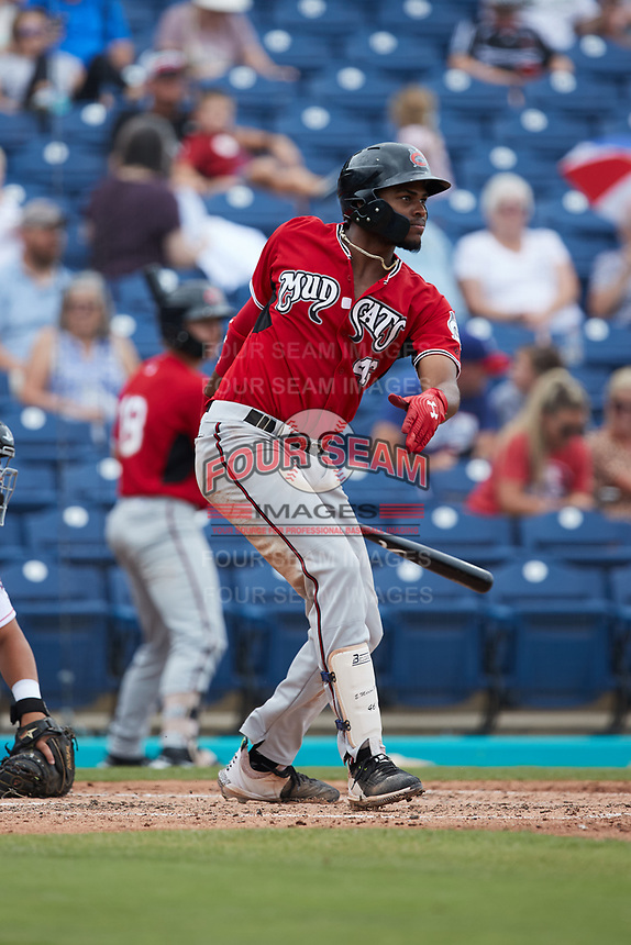 Ernesto Martinez (46) of the Carolina Mudcats follows through on his swing against the Kannapolis Cannon Ballers at Atrium Health Ballpark on July 18, 2021 in Kannapolis, North Carolina. (Brian Westerholt/Four Seam Images)