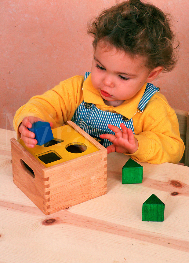 Toddler plays with shapes