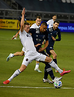 KANSAS CITY, KS - OCTOBER 07: #27 Robert Beric of Chicago Fire FC and  #22 Winston Reid of Sporting Kansas City battle for the ball during a game between Chicago Fire and Sporting Kansas City at Children's Mercy Park on October 07, 2020 in Kansas City, Kansas.