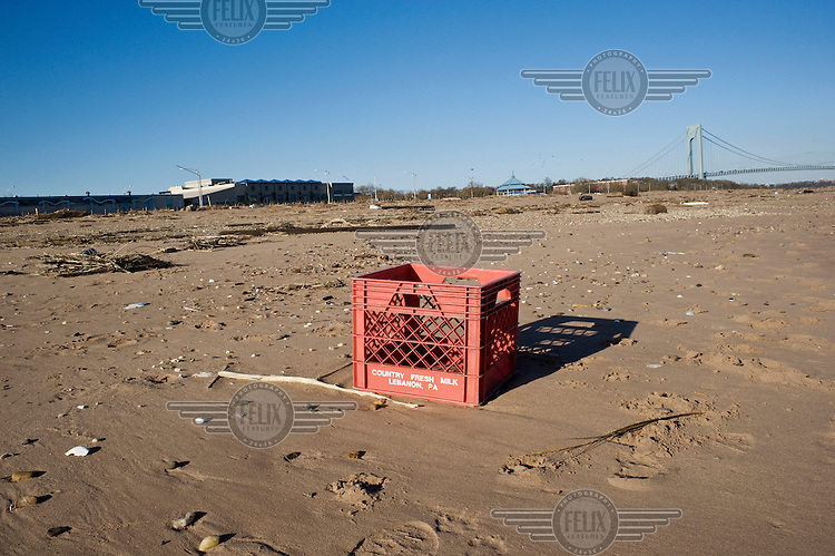 A red food handling container sits on South Beach Staten Island in the wake of Tropical Storm Sandy, which hit New York and other parts of the north eastern United States on the evening of 29 October 2012.
