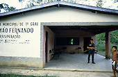 Altamira, Brazil. Irmao Fernando municipal school with armed guard with rifle.