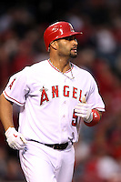 Albert Pujols #5 of the Los Angeles Angels runs to first base against the Minnesota Twins at Angel Stadium on May 2, 2012 in Anaheim,California. Los Angeles defeated Minnesota 9-0.(Larry Goren/Four Seam Images)
