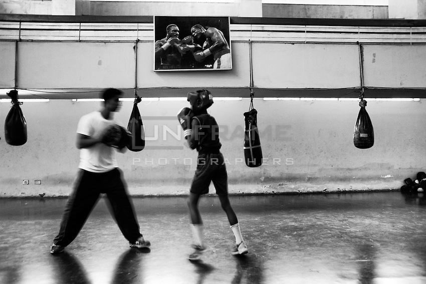 A young boy practices boxing in BKSP. Gazipur, Dhaka, Bangladesh