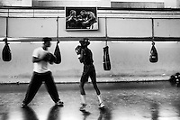 A young boy practices boxing in BKSP. Gazipur, Dhaka, Bangladesh