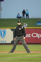 Umpire Ryan Goodman handles the calls on the bases during the Pacific Coast League game between the Omaha Storm Chasers and the Memphis Redbirds at Werner Park on April 24, 2015 in Papillion, Nebraska.  (Stephen Smith/Four Seam Images)
