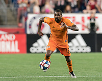 FOXBOROUGH, MA - JUNE 29: Chris Duvall #12 brings the ball forward during a game between Houston Dynamo and New England Revolution at Gillette Stadium on June 29, 2019 in Foxborough, Massachusetts.