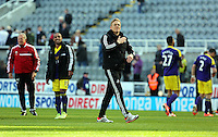 Pictured: Swansea head coach Garry Monk takes to the pitch to thank away supporters after the final whistle. Saturday 19 April 2014<br />