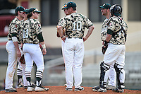 Slippery Rock head coach Jeff Messer (10) talks with (clockwise) Preston Falascino (18), Jake Nogalo (7), Jordan Faretta (hidden), Carson Kessler (17), Jon Anderson (19) and Alex Bell (14) during a game against the Kentucky Wesleyan Panthers on March 9, 2015 at Jack Russell Stadium in Clearwater, Florida.  Kentucky Wesleyan defeated Slippery Rock 5-4.  (Mike Janes/Four Seam Images)