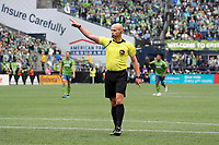 SEATTLE, WA - NOVEMBER 10: Referee Allen Chapman signals for a corner kick during a game between Toronto FC and Seattle Sounders FC at CenturyLink Field on November 10, 2019 in Seattle, Washington.