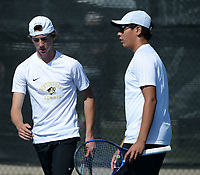 Bentonville's Santiago Aguirre (right) and doubles partner Boyce Read compete Tuesday, Oct. 12, 2021, during the 6A state tennis finals at Memorial Park in Bentonville. Visit nwaonline.com/211013Daily/ for today's photo gallery.<br /> (NWA Democrat-Gazette/Andy Shupe)