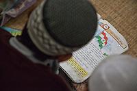 Madrasa Student Reading about the Flag of India, Madrasa Imdadul Uloom, Dehradun, India.