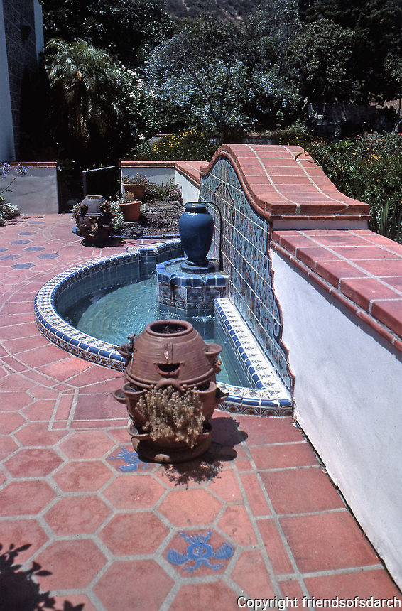 The Adamson House patio, designed by a well-known architect, Stiles Clements, was constructed beginning in 1929. Detail of water fountain and Spanish tile. Situated near the Malibu Pier between popular Surfrider Beach and the Malibu Lagoon, the house boasts an exotic mix of Spanish and Moorish influences.It is now the Malibu Lagoon Museum. Photo--July 1989.