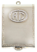 BNPS.co.uk (01202 558833)<br /> Pic: SheldonCarpenter/Witherell'sInc/BNPS<br /> <br /> Pictured: Al Capone's 14k white gold and diamond matchbook cover.<br /> <br /> An incredible treasure trove of Al Capone heirlooms have sold at auction for a whopping £2.3m. ($3.1m)<br /> <br /> The star lot was the notorious American gangster's favourite gun - a 1911 Colt semi-automatic pistol, which was expected to fetch £110,000 but sold for an incredible £764,000. ($1.04m)<br /> <br /> The remarkable collection, sold by his granddaughters, included personalised jewellery, photographs and furniture and a letter written to his only child Sonny from Alcatraz Prison, which showed a tender side to the ruthless crime boss.