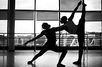 Lexis Wright, a senior at CAPA, and Jaumair Garland, junior, dance together with a view of the sister bridges in the background at the CAPA school on Monday September 24, 2018 in downtown Pittsburgh, Pennsylvania. (Photo by Jared Wickerham/City Paper)
