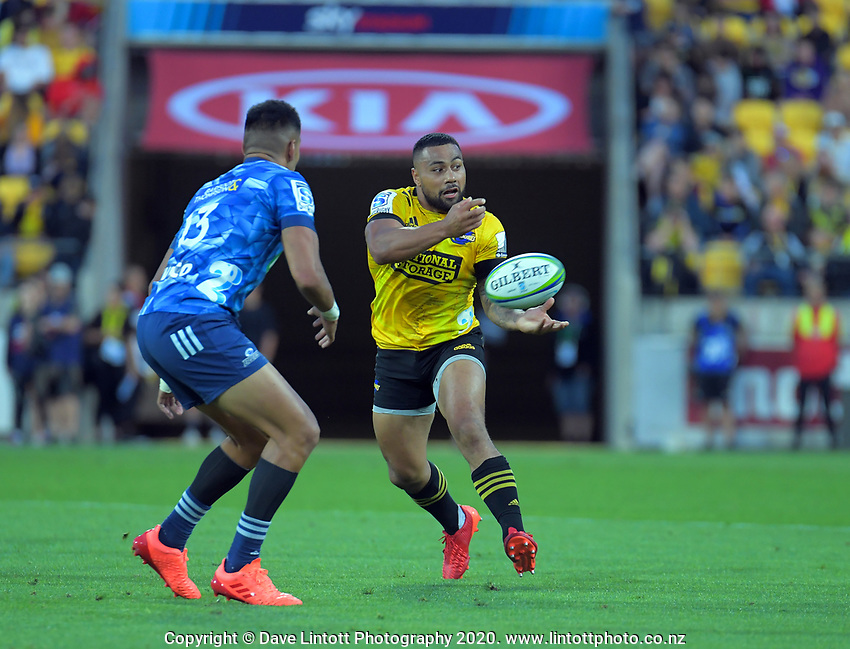 Ngani Laumape passes during the Super Rugby match between the Hurricanes and Blues at Sky Stadium in Wellington, New Zealand on Saturday, 7 March 2020. Photo: Dave Lintott / lintottphoto.co.nz