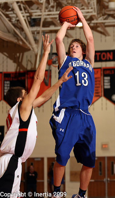 SIOUX FALLS, SD - DECEMBER 29: Sterling Nielsen #13 of O'Gorman looks for the jumper over Alex Holm #10 of Washington in the second half of their game Tuesday night at Washington. (Photo by Dave Eggen/Inertia)