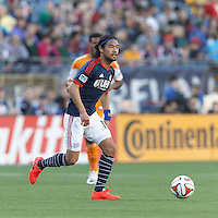 New England Revolution midfielder Daigo Kobayashi (16) looks to pass at midfield. In a Major League Soccer (MLS) match, the New England Revolution (blue/white) defeated Houston Dynamo (orange), 2-0, at Gillette Stadium on April 12, 2014.