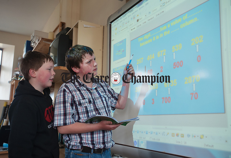 Mathematicians David Mullins and James Kelly solve a problem at Boston National School. Photograph by John  Kelly.