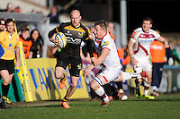 Joe Simpson of London Wasps accelerates past Eifion Lewis-Roberts of Sale Sharks to score a try during the Aviva Premiership match between London Wasps and Sale Sharks at Adams Park on Saturday 1st March 2014 (Photo by Rob Munro)