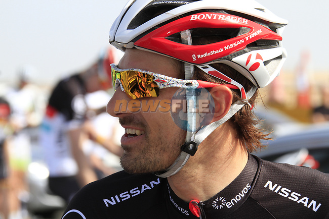 Radioshack-Nissan Trek rider Fabian Cancellara (SUI) relaxes before the 2nd Stage of the 2012 Tour of Qatar an 11.3km team time trial at Lusail Circuit, Doha, Qatar. 6th February 2012.<br /> (Photo Eoin Clarke/Newsfile)