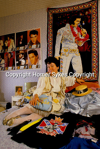 'ELVIS FANS', VALERIE CONSTABLE IN HER BEDROOM WHERE THE WALLS ARE COVERED WITH POSTERS OF HER IDOL, SOUTH LONDON