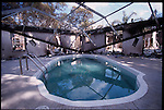 4-21-01.In North Port Florida, the screening to Ray and Maria Delfa's pool had burnt off its supports during a wildfire that burnt the rest of the house to the ground.