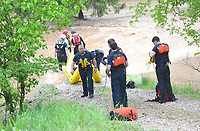 Bella Vista and Rogers Fire Department water rescue personnel assisted Little FLock in rescuing two men from the flood waters on Rustic Drive in Little Flock.