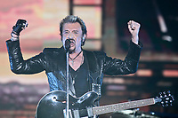 Johnny Hallyday performs at the 45th Festival d'ete de Quebec on the Plains of Abraham in Quebec city Tuesday July 10, 2012. The Festival d'ete de Quebec is Canada's largest music festival with more than 1000 artists and close to 300 shows over 11 days.