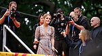 Hermoine Granger played by Emma Watson greets..the cheers of the crowd as the climbs a gantry on the way into the World Premiere of Harry Potter and the Half Blood Prince....Picture by Gavin Rodgers/ Pixel 07917221968