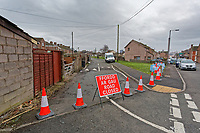 "Pictured: The road has been closed off for traffic leading to the Banksy graffiti on a garage in Port Talbot, Wales, UK. Tuesday 25 December 2018<br /> Re: The artist Banksy has confirmed that a new graffiti piece that has appeared in Port Talbot, south Wales is his.<br /> He announced on Instagram: ""Season's greetings"" - with a video of the artwork in the Taibach area of Port Talbot.<br /> The image appears on two sides of a garage in a lane near Caradog Street, depicting a child enjoying snow falling - the other side reveals it is a fire emitting ash.<br /> The owner of the garage said he had not slept over fears it might be vandalised."