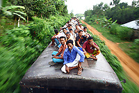 Passengers perched on the roof of a train. In Bangladesh many people ride on the roofs of trains as frequently that is the only space available. For others, the fares are too high and can be avoided or reduced by travelling on the roof. However, the riding on roofs and other parts of train exteriors leads to regular accidents, many of them fatal..
