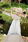PEDESTRIAN BRIDGE OF GRANITE SLABS AT JAPANESE GARDEN