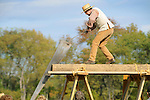 Heritage Days Festival. Union County. Colonial man hand sawing fence post.