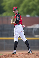 Hickory Crawdads starting pitcher Matt Ball (18) checks the runner at first base against the Delmarva Shorebirds at L.P. Frans Stadium on June 18, 2016 in Hickory, North Carolina.  The Crawdads defeated the Shorebirds 1-0 in game one of a double-header.  (Brian Westerholt/Four Seam Images)