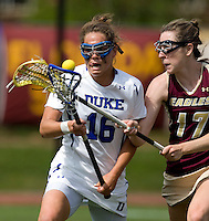 Kim Wenger (16) of Duke fights for the ball with Peyton Killeen (17) of Boston College during the first round of the ACC Women's Lacrosse Championship in College Park, MD.  Duke defeated Boston College, 17-6.